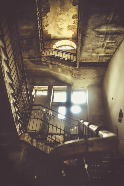 Abandoned Palace in Warsaw: Staircase of an abandoned Palace. The photo of the staircase from the first floor to the first floor and second floor. The hotel itself is located in the neighborhood of the capital city of Warsaw.