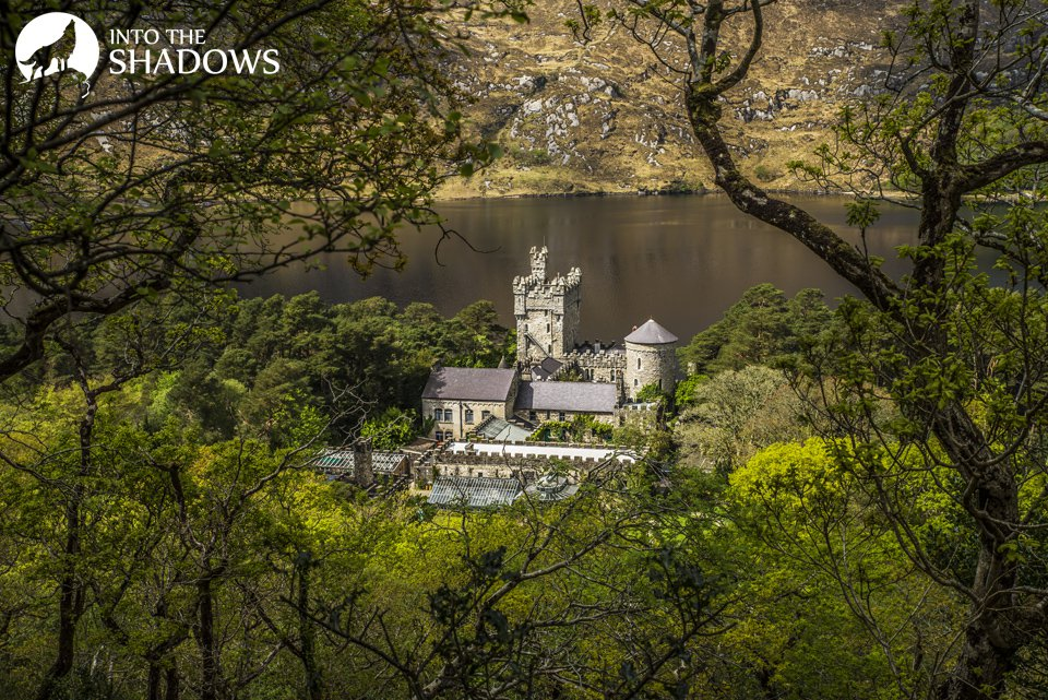 View of the monastery from the top of the hill: Abbey in County Galway, on the shores of Kylemore Lough. It was built in the Gothic revival style during Mitchell Henry in 1868. The view from a nearby hill.