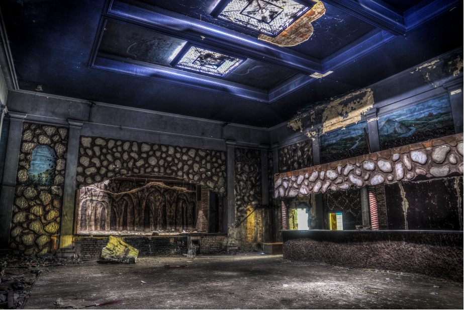 Club Grotto (Working): Photo shows the main hall and a bar in an abandoned club Grotto. On special attention deserves here the amazing scenery, reminiscent of stone trees and paintings on the walls.