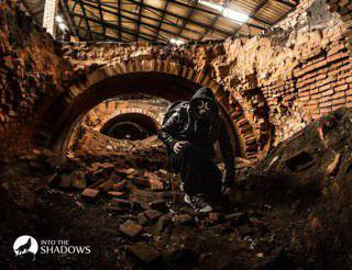 Explorer in an abandoned brick factory